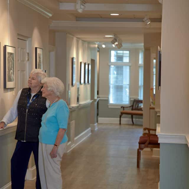Goddard House residents admiring gallery